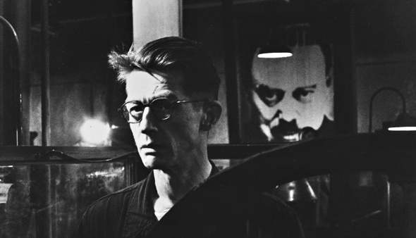 """John Hurt as Winston Smith in """"1984"""" with Big Brother looking on."""